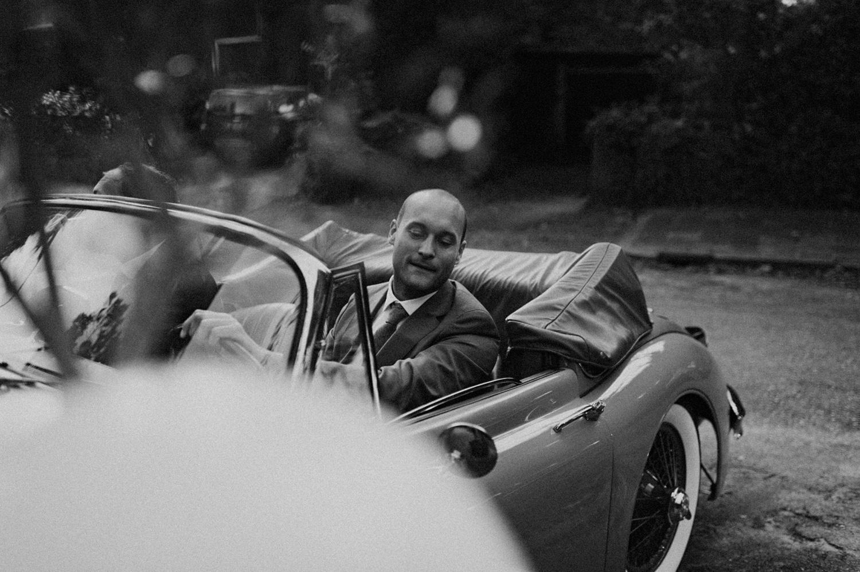 Groom arriving in oldtimer car