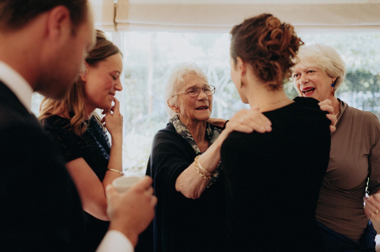 Grandmother of bride hugging people