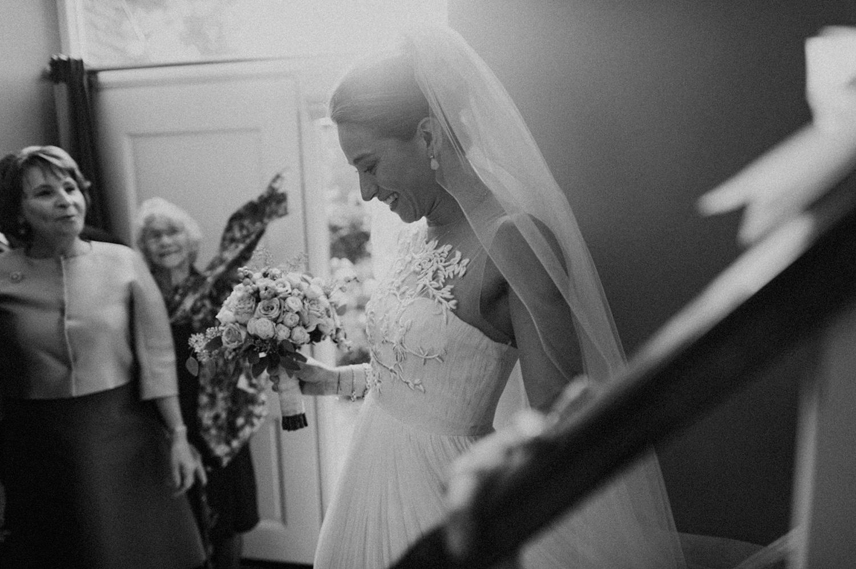Bride walking down the stairs towards groom