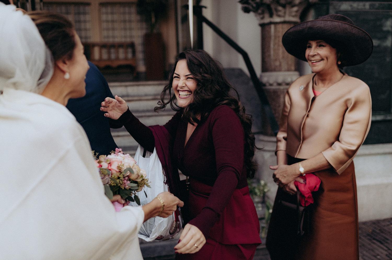 Weddings guests  welcoming bride with big smile