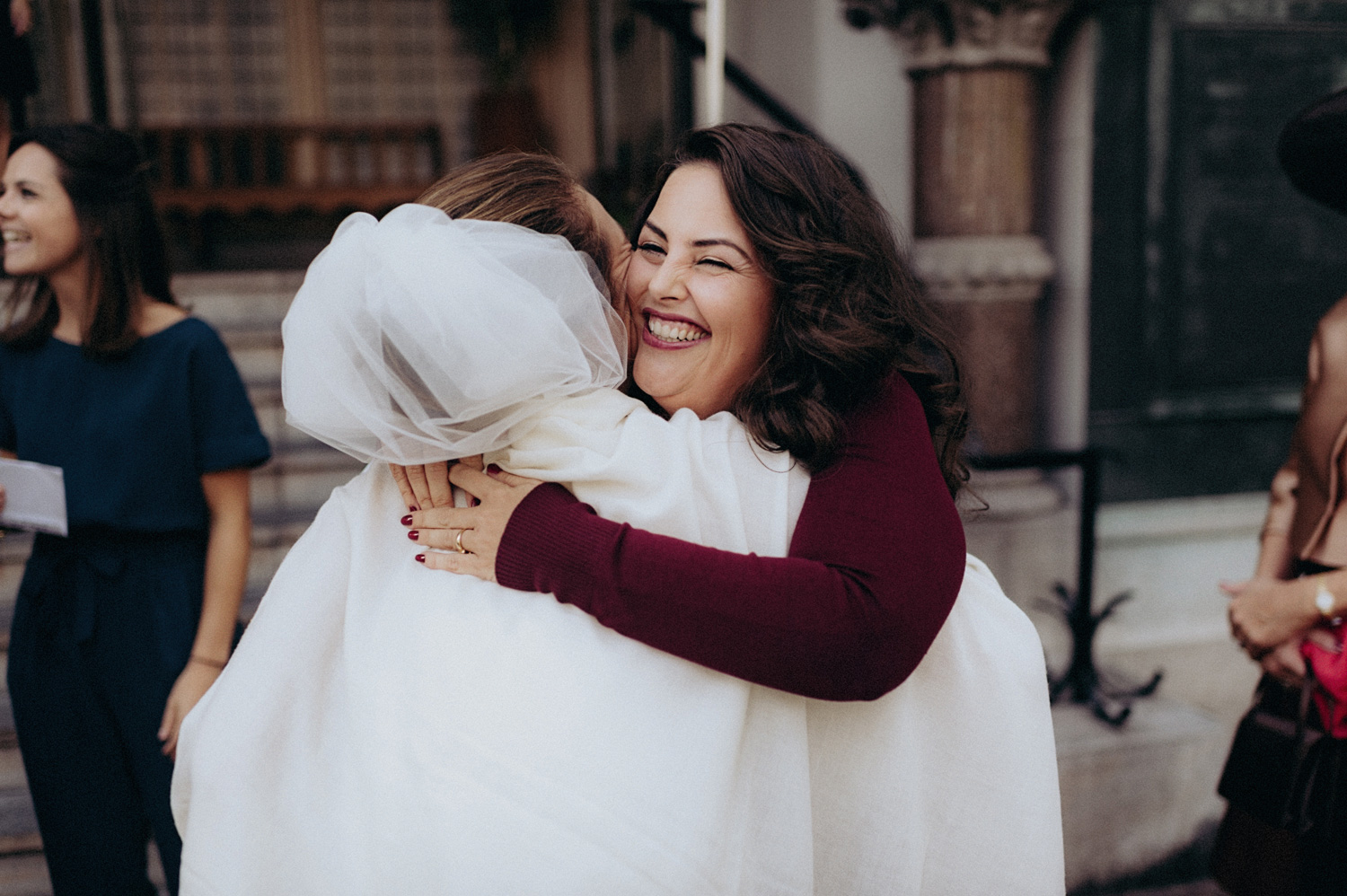 Best friend of bride hugging with smile