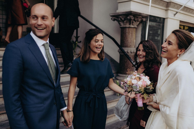 Bride and groom at entrance of Keizersgracht Kerk Amsterdam