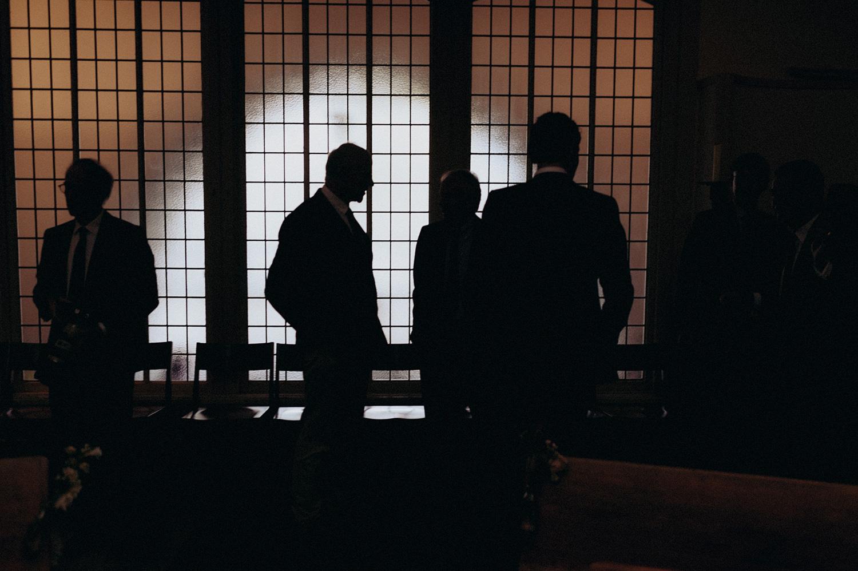 Silhouette shot of wedding guests inside Keizersgracht Kerk Amsterdam