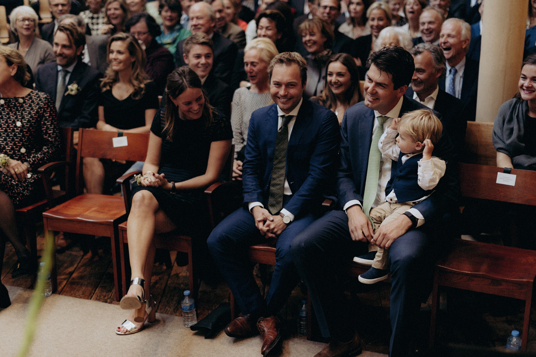 Smiling weddings guests in Keizersgracht Kerk Amsterdam