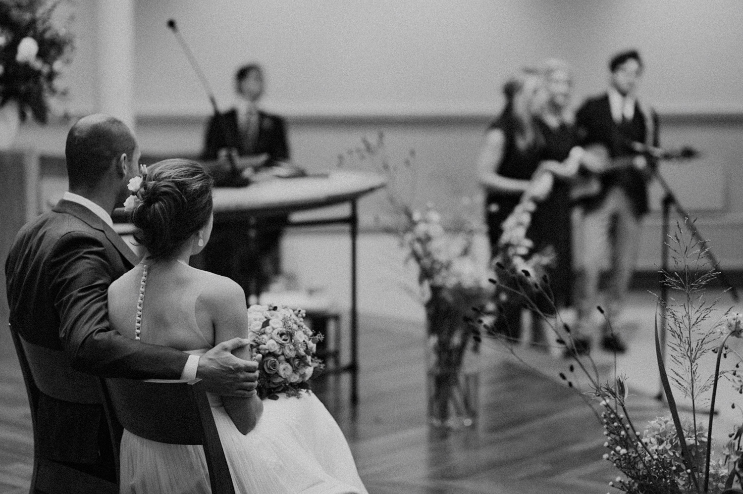 Groom holding his bride watching music and singing