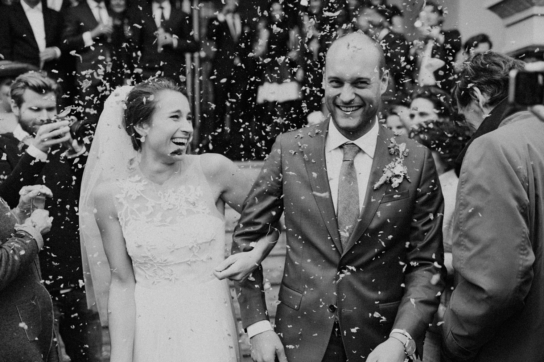 Huge smiling bride while leaving ceremony after getting married at Keizersgracht Kerk Amsterdam