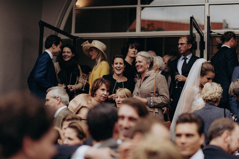 Wedding guests celebrating at entrance of Keizersgracht Kerk Amsterdam