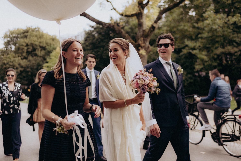 Close up of Bride with friend in Vondelpark, Amsterdam