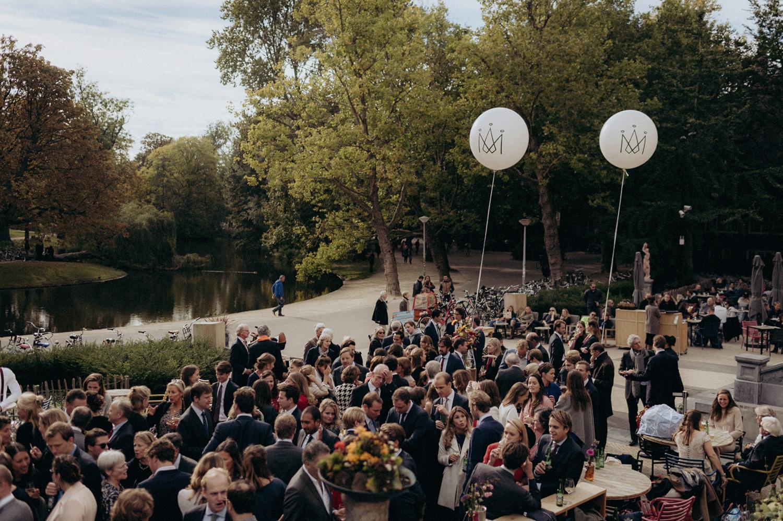 Terrace of VondelCS with wedding guests in Vondelpark