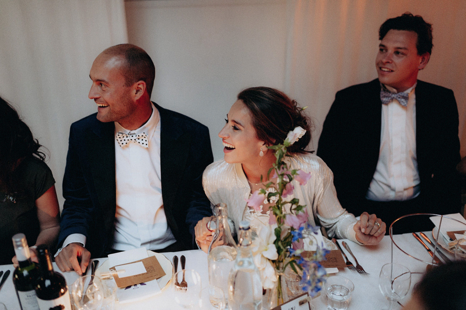 Bride and groom laughing while dining at Rijk van de Keizer