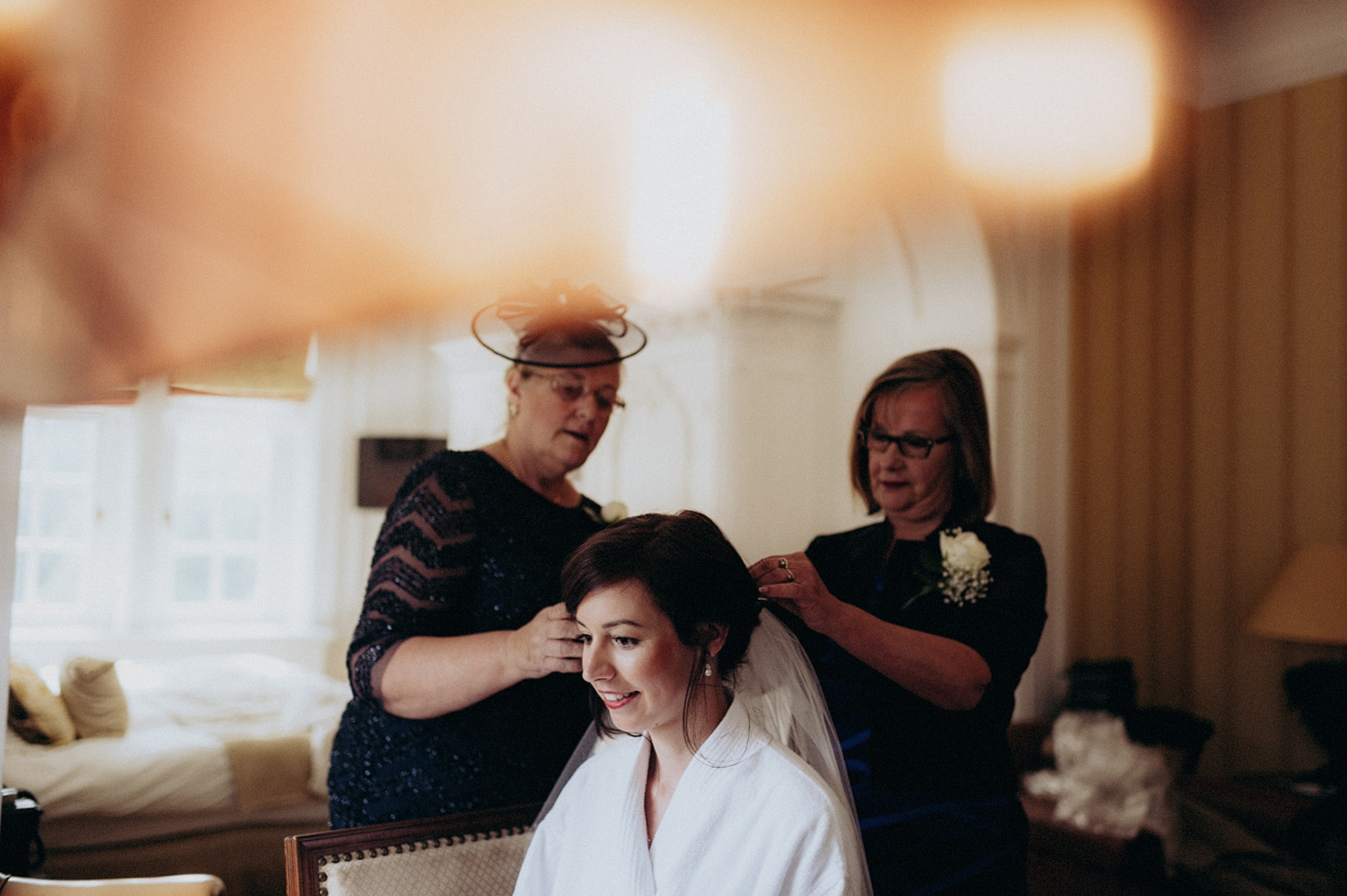 Bride getting her veil done by mother