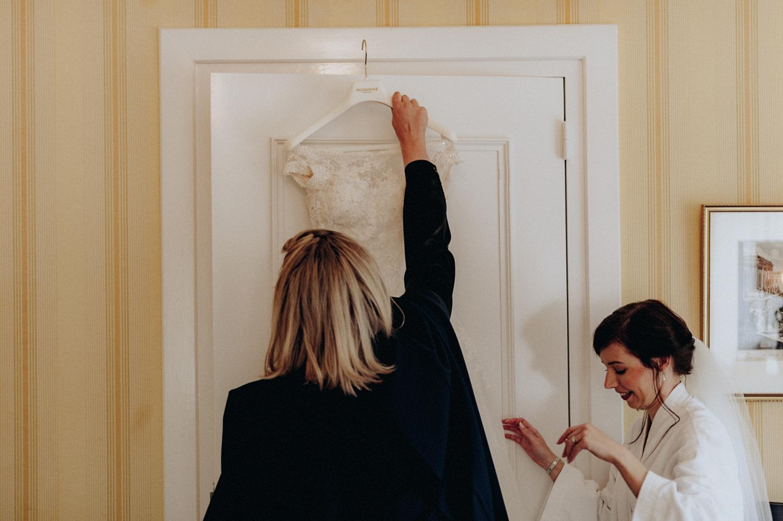 Taking wedding dress of door