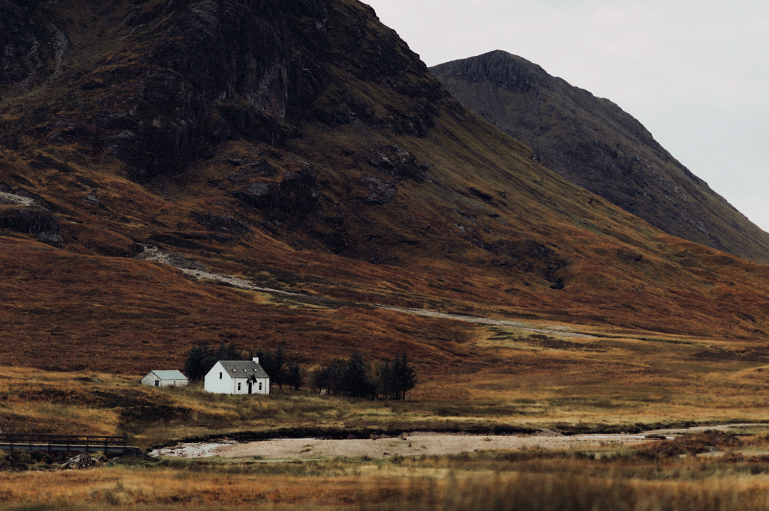 White Cottage at River Coupall Valley in Scotland