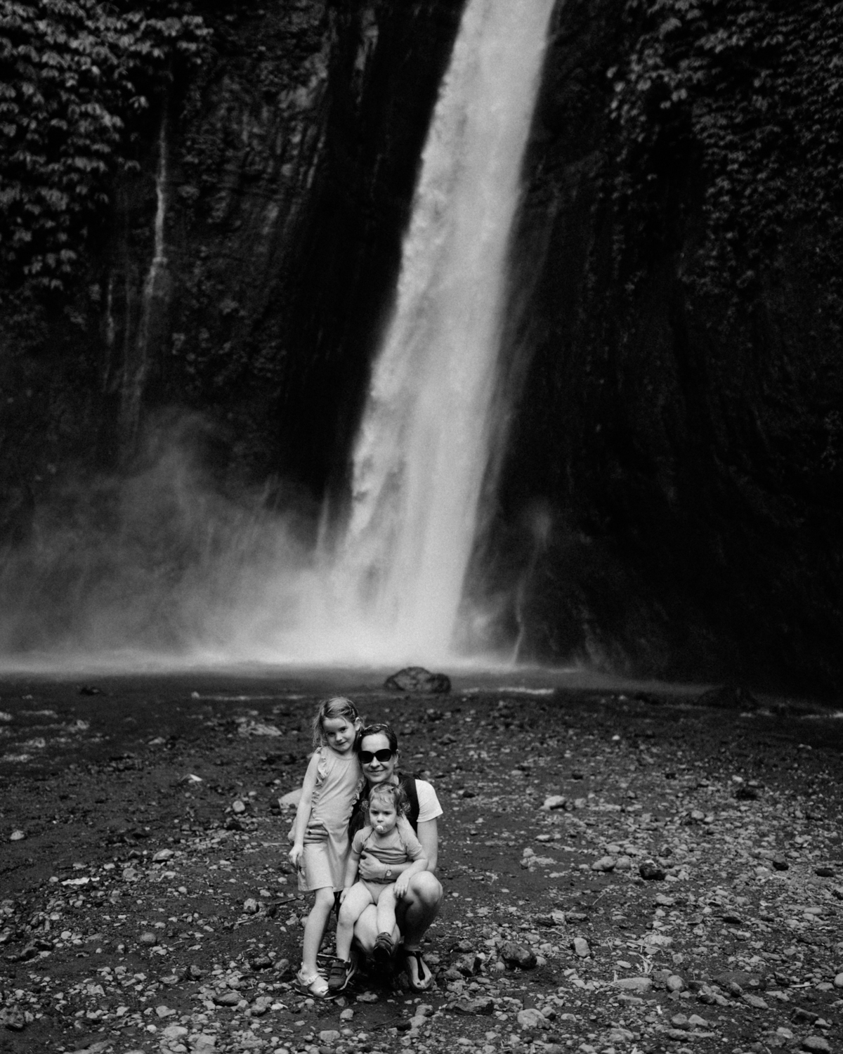 People in front of waterfall