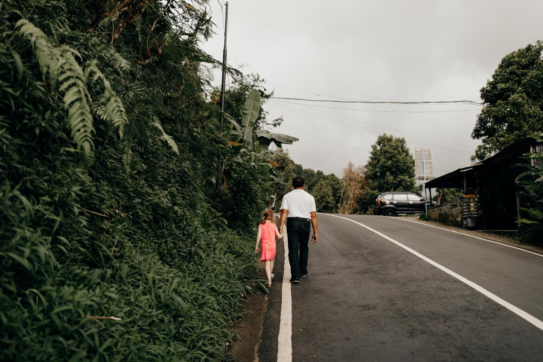 People walking next to road