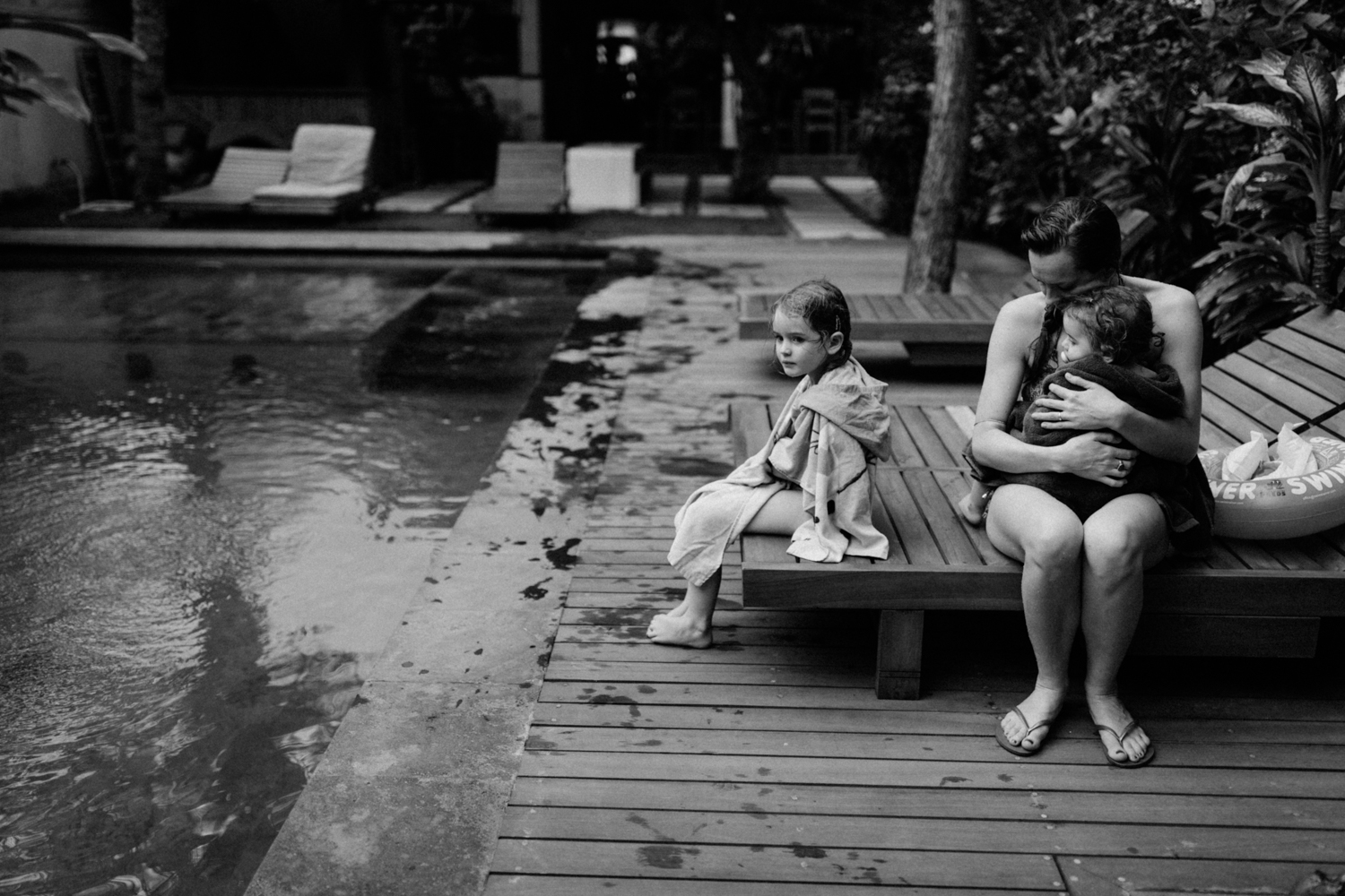 Kids with mother near pool
