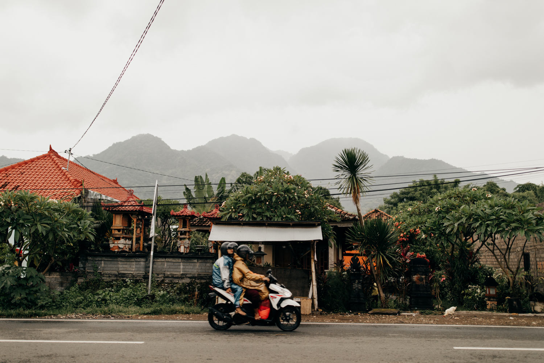 Scooter driving in Permuteran, Bali, Indonesia