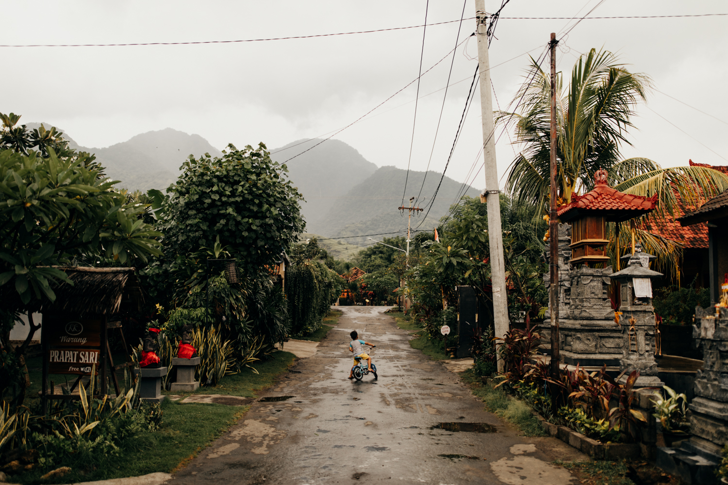 Kid on road with mountain in the background in Bali, Indonesia