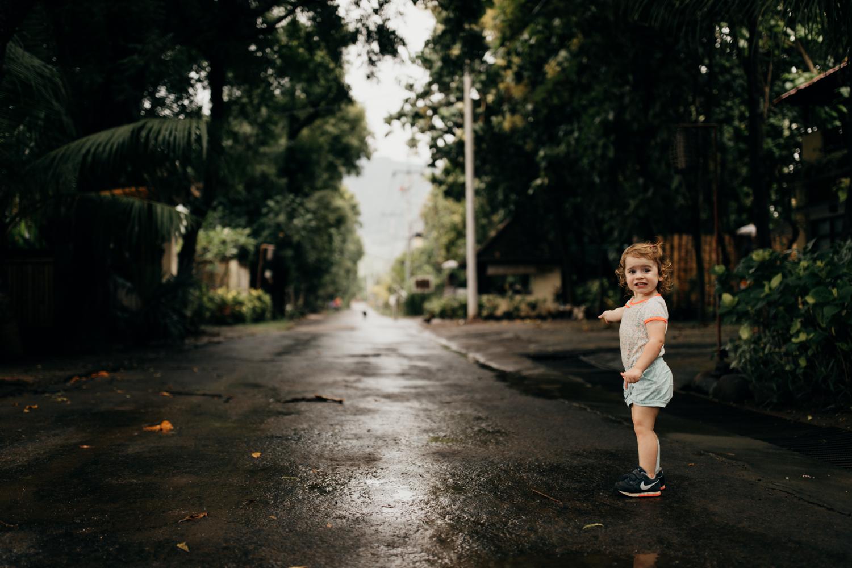Kid pointing at road