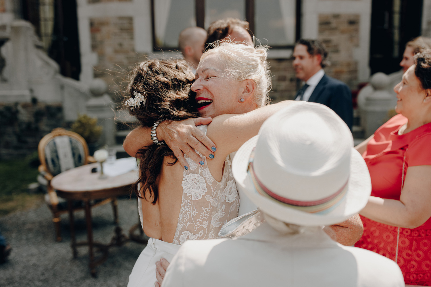 Bride hugging guests after ceremony