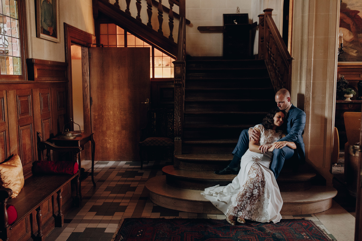 Bride and Groom at stairs in Chateau de Presseux