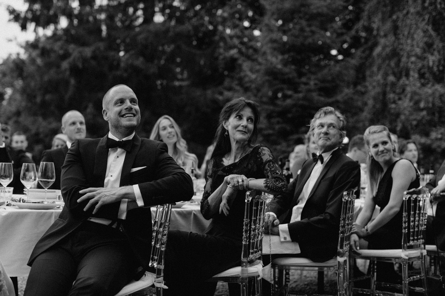Groom laughing during speech at Chateau de Presseux