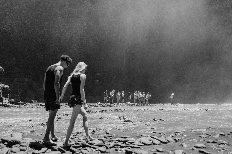 Couple walking together at Tegenungan Waterfall, Bali
