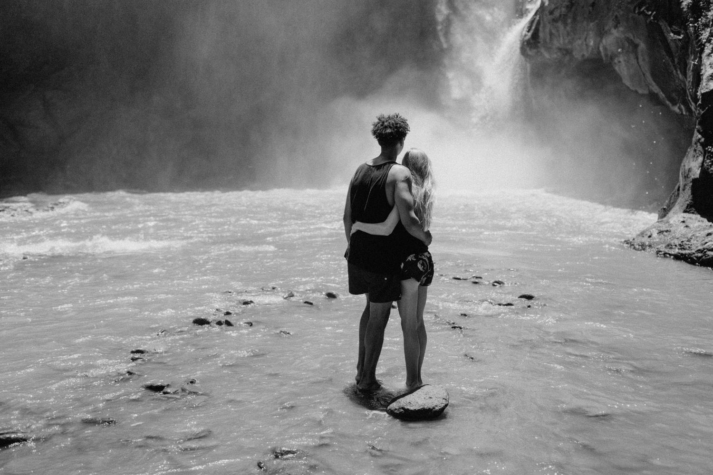 Couple looking at Tegenungan Waterfall, Bali
