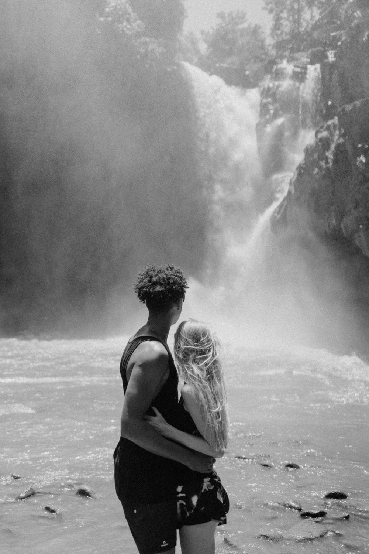Portrait of couple at Tegenungan Waterfall, Bali