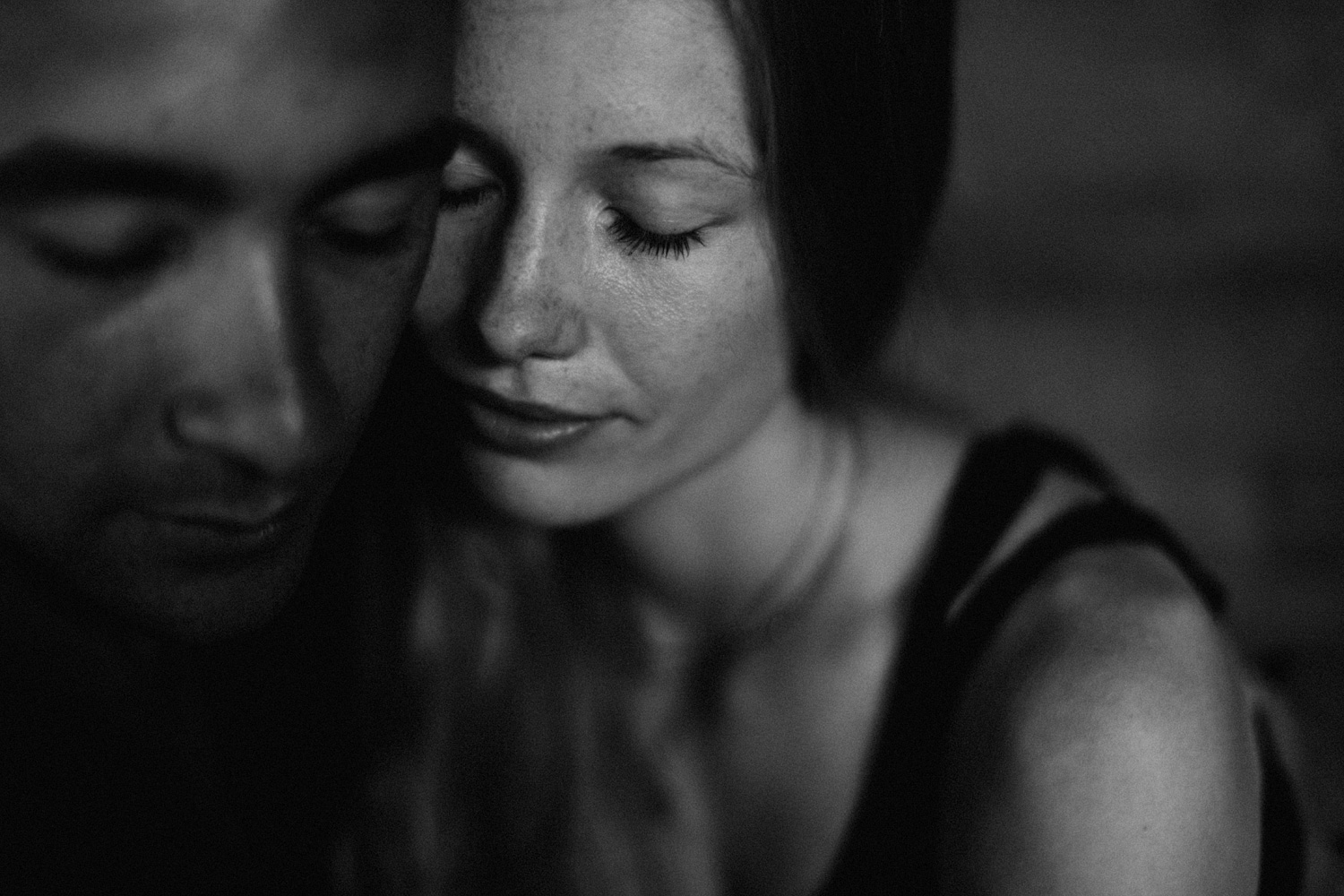 Close up portrait of couple with closed eyes in Bali