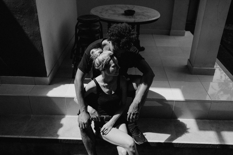 Couple sitting in beam of light at Ubud, Bali