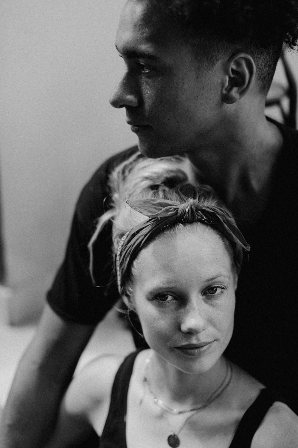 Black and white couple with girl facing the camera and hairband
