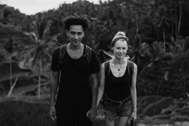 Portrait of couple facing camera at Tegalalang Rice Terrace, Bali