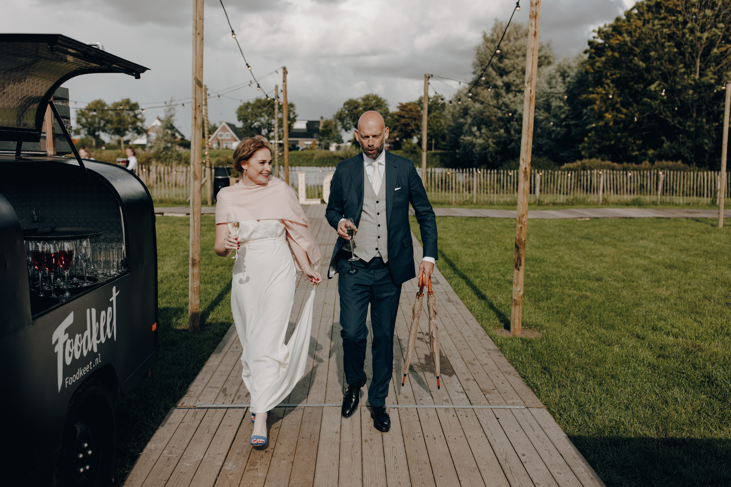 Bride and Groom arriving at outdoor wedding