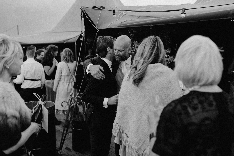 People hugging at wedding