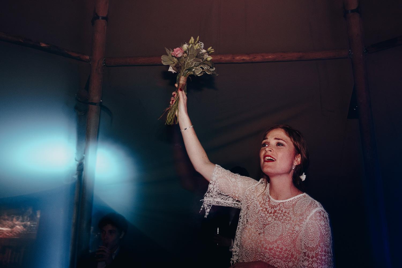 Bride throwing wedding bouquet