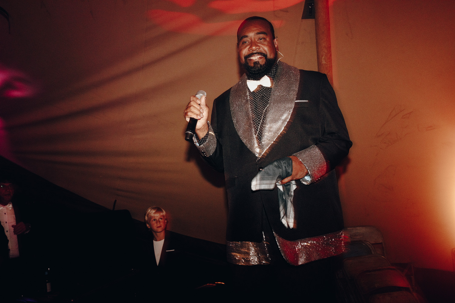 Barry White impersonator at wedding smiling