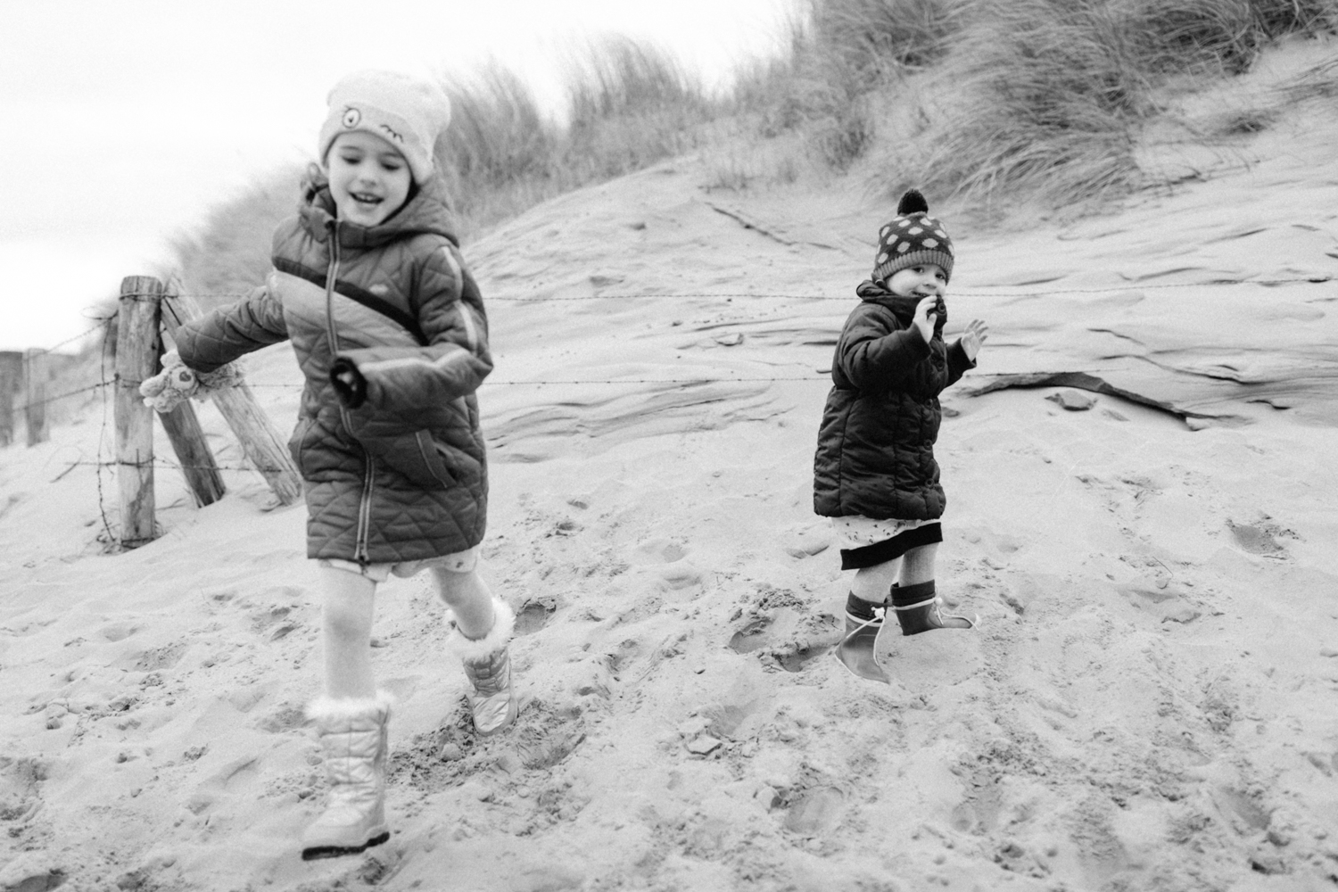 Sisters running and playing at the beach