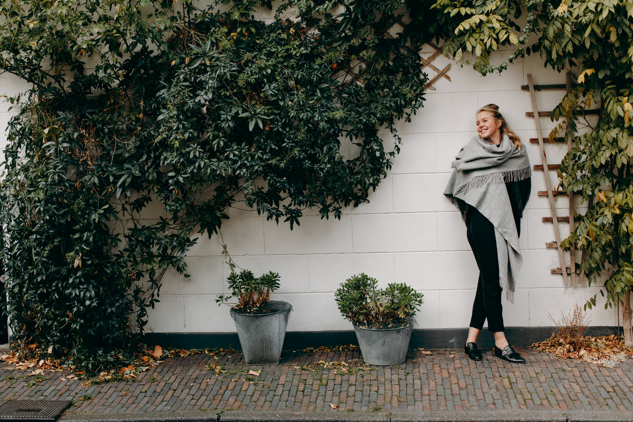 Portrait of Marieke in front of wall with plants