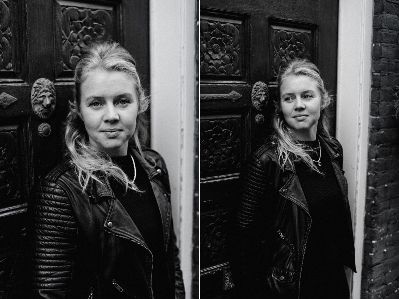 Black and white portrait of Marieke by door