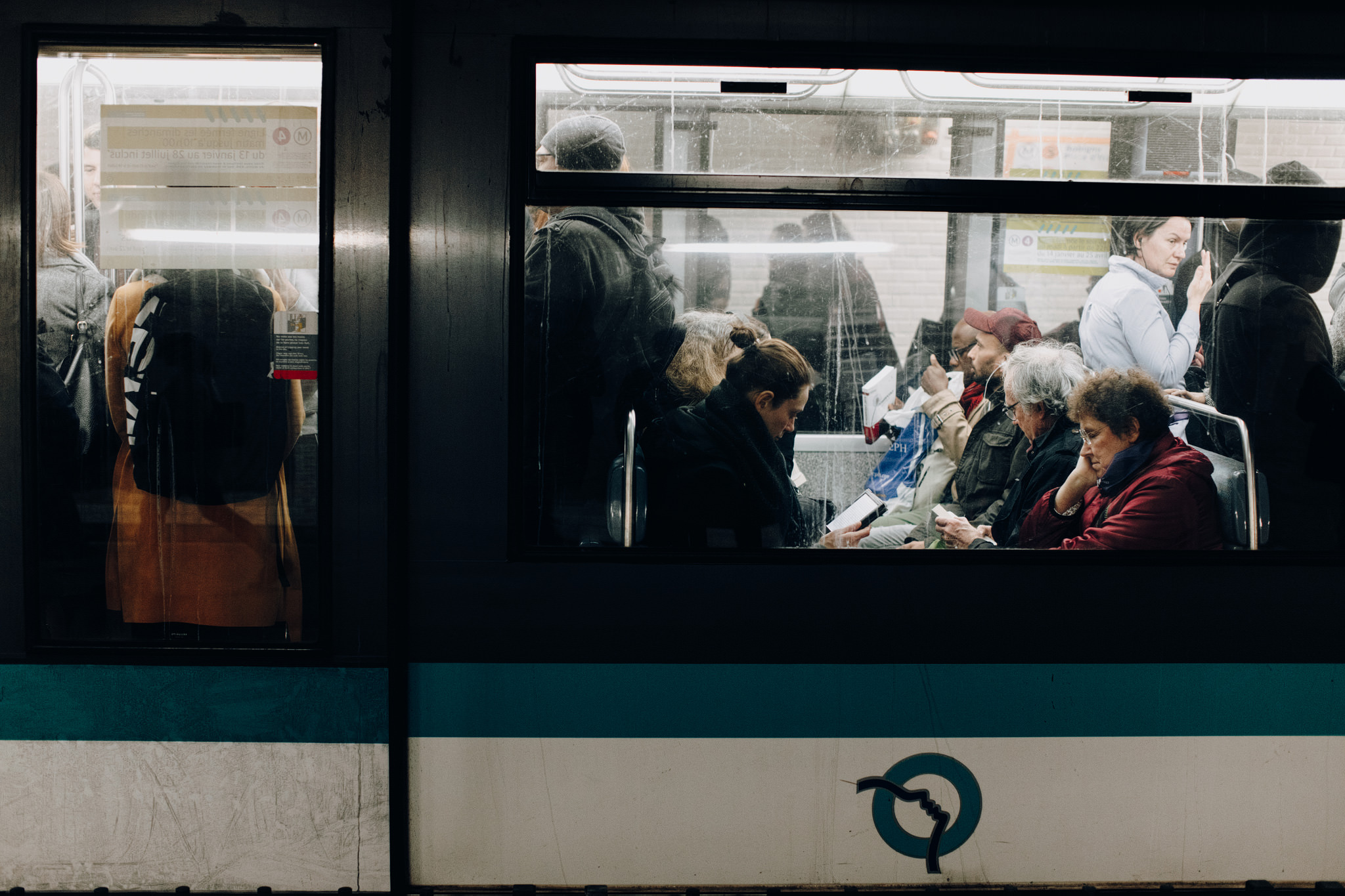 People sitting in metro in Paris, France