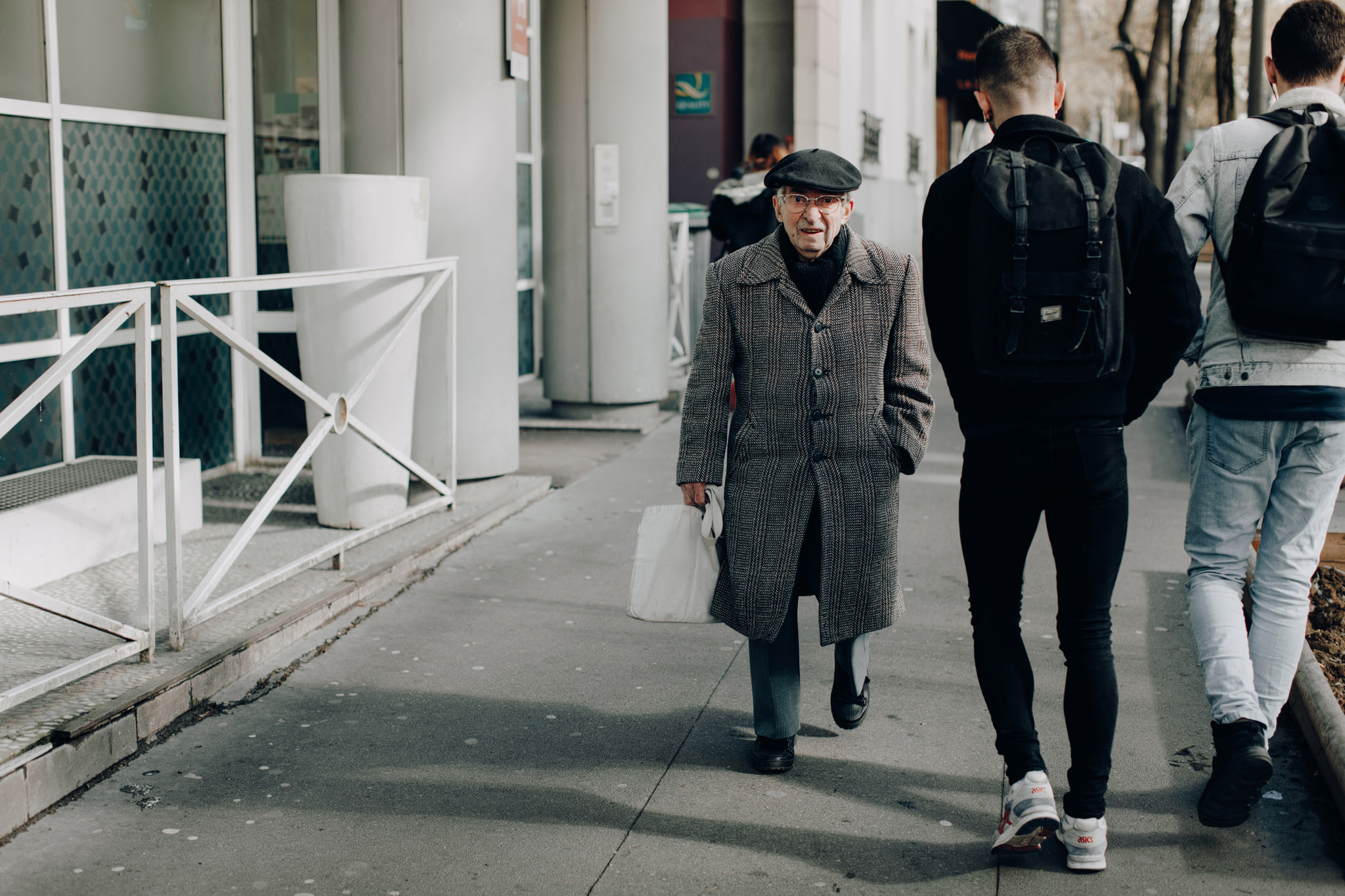 Old French man walking the streets of Paris