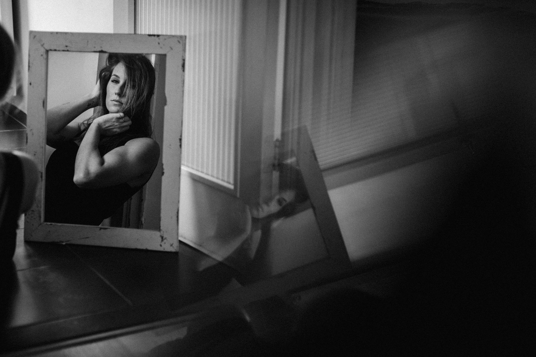Girl in mirror facing camera