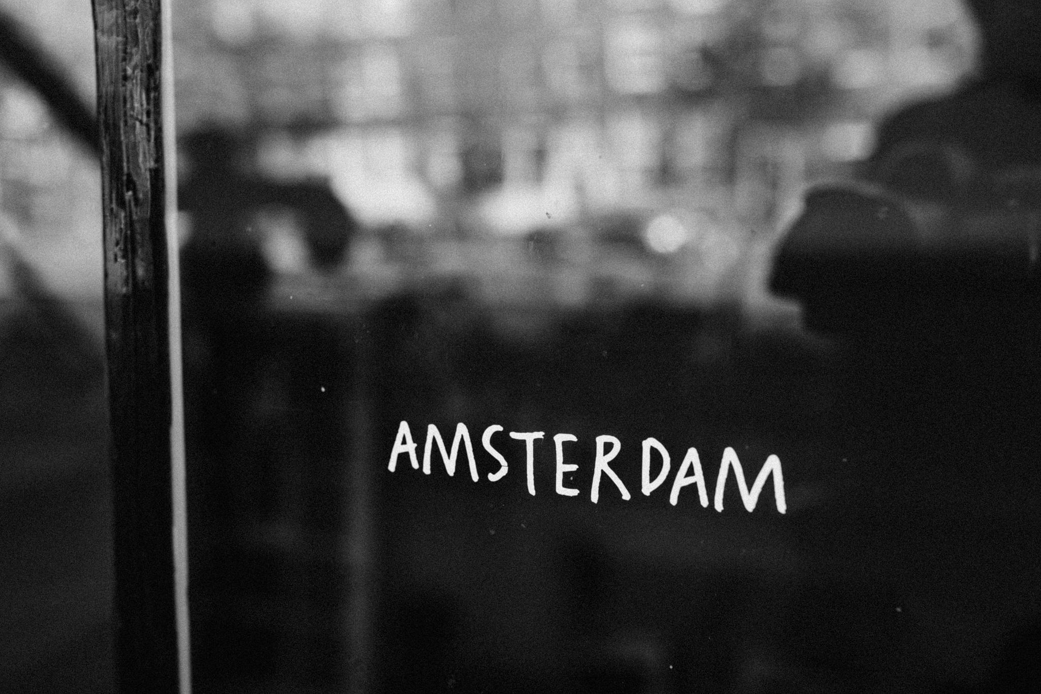 Amsterdam sign written on window