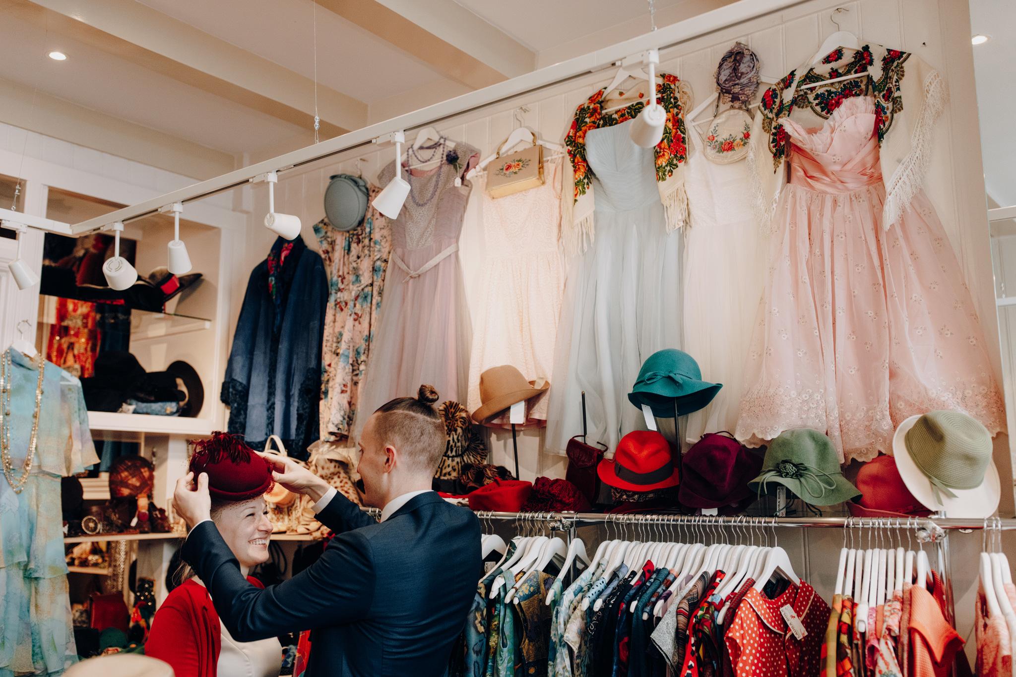 Couple fitting hats in shop in Negen straatjes Amsterdam