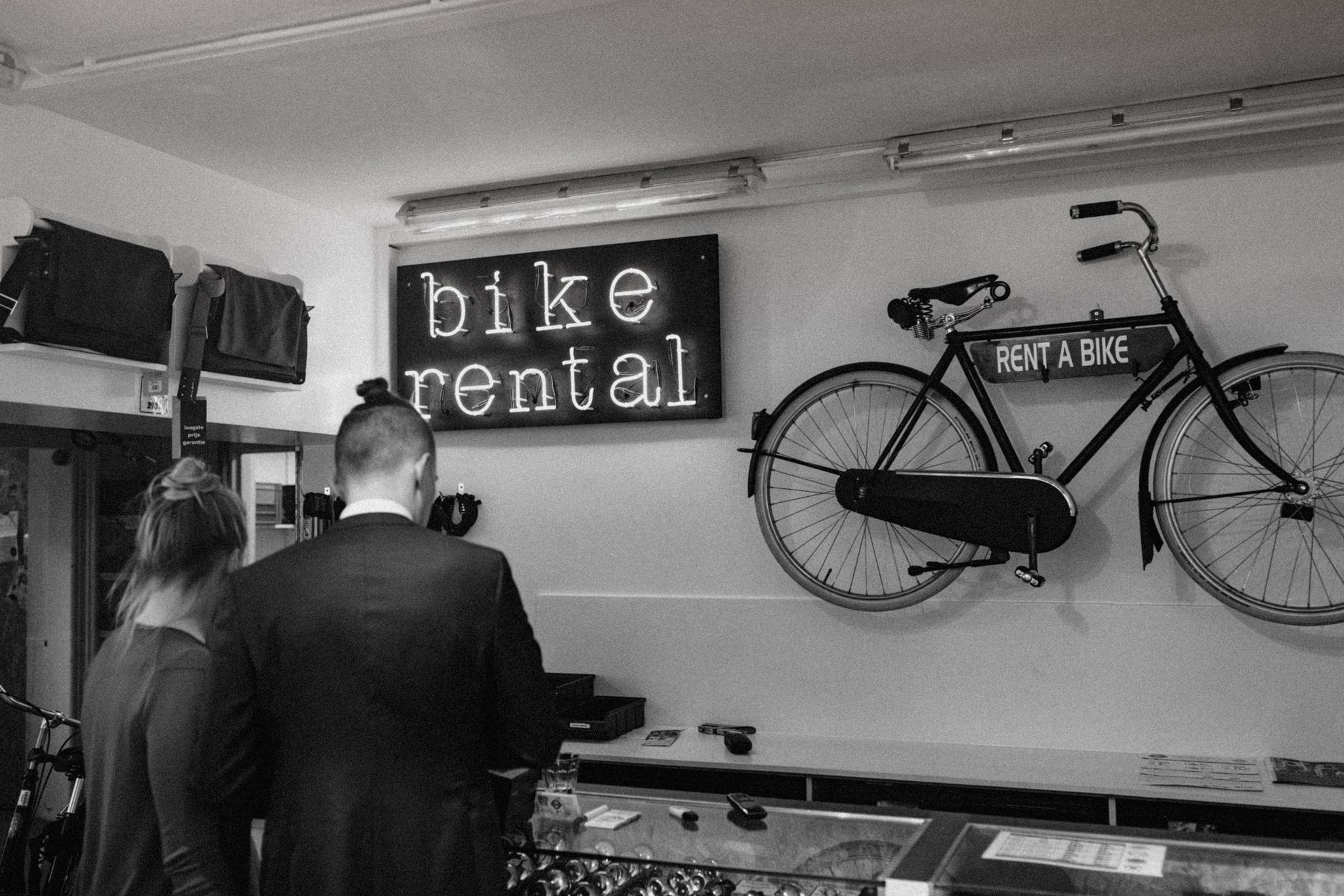 Bike rental sign inside of bike rental shop in Amsterdam