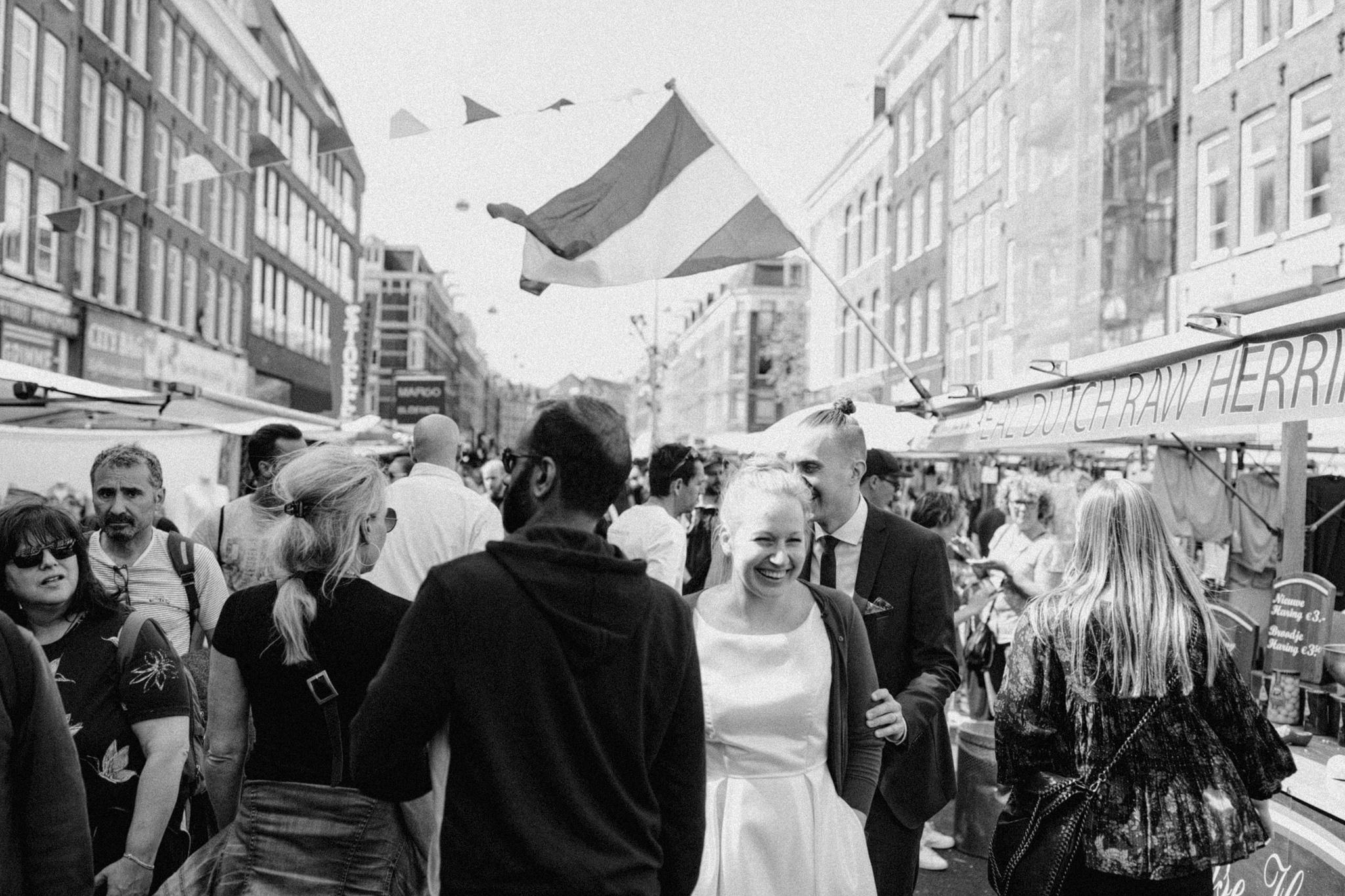 Elopement couple smiling at Albert Cuyp market