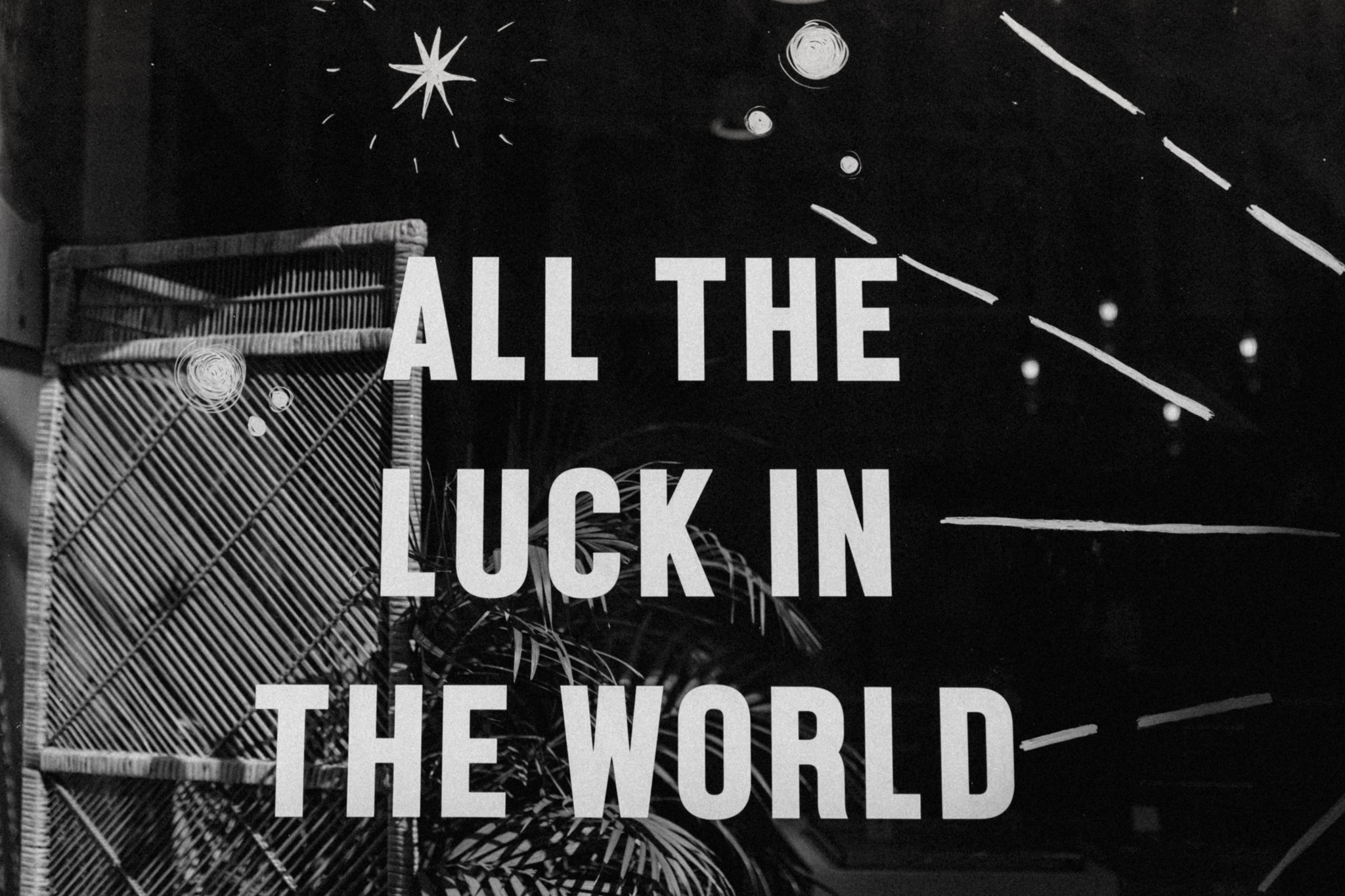 All the luck in the world sign on window