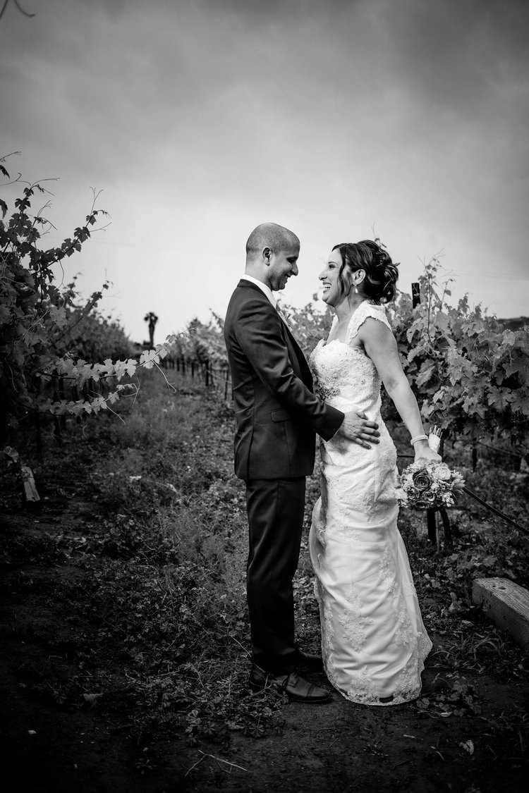 Black and white wedding photo at a vineyard