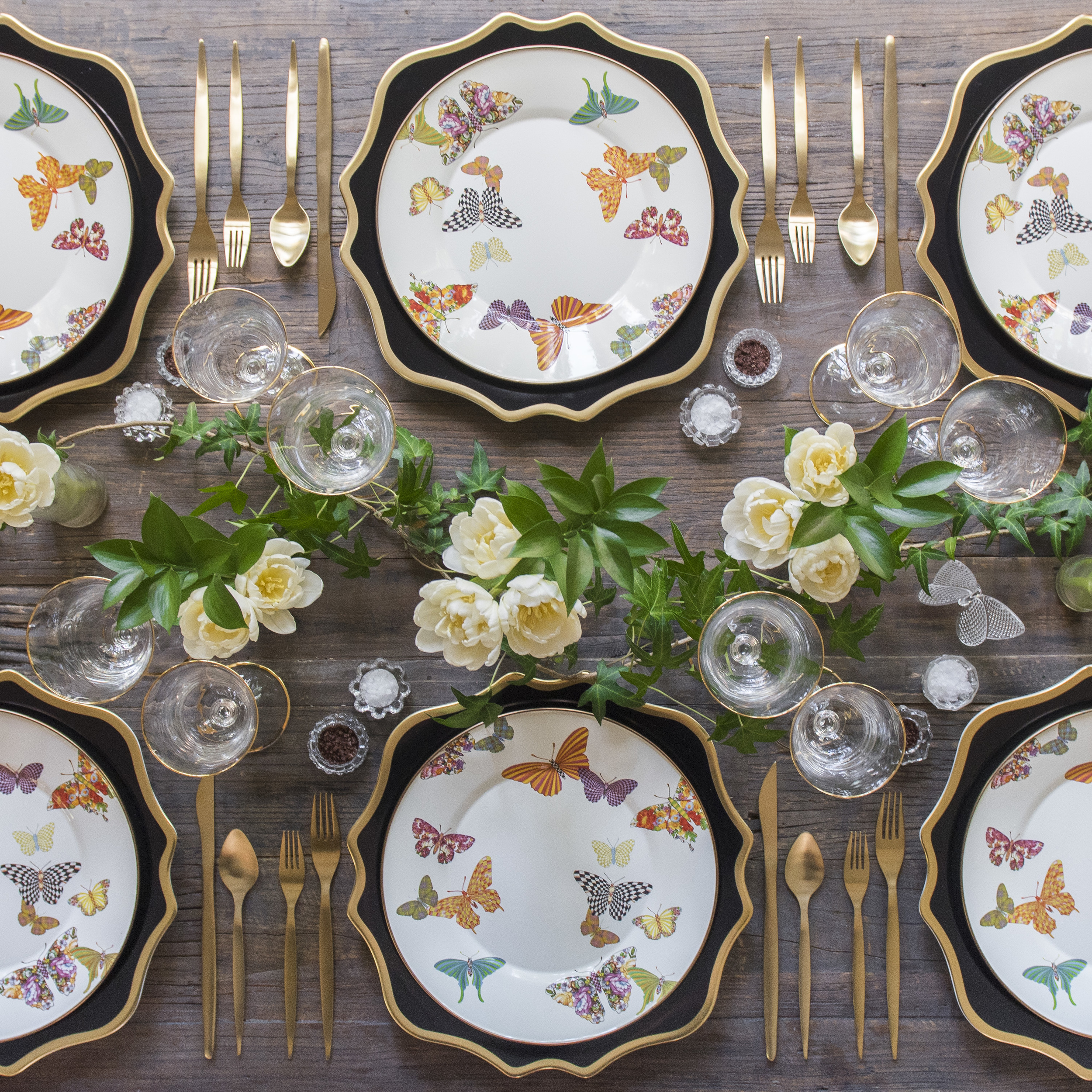 RENT: Anna Weatherley Chargers in Black/Gold + MacKenzie-Childs Butterfly Garden Collection + Celeste Flatware in Matte Gold + Chloe 24k Gold Rimmed Stemware + Antique Crystal Salt Cellars  SHOP: Chloe 24k Gold Rimmed Stemware